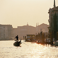 A gondola on the Grand Canal at sunset, Venice, Italy