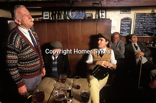 Local men sing traditional songs and recite stories and poetry. Kings Head Laxfield Suffolk