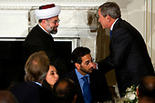 Washington, D.C. - October 16, 2006 -- United States President George W. Bush and The Imam Tala Eid, of the Islamic Institute of Boston shake hands following remarks and a toast to Muslim leaders at the annual Iftaar dinner in the State Dining Room of the White House.  <br /> Credit: Jay L. Clendenin - Pool via CNP