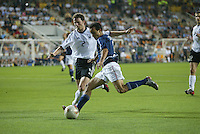 Landon Donovan tries to shoot the ball past Thomas Linke. The USA lost to Germany 1-0 in the Quarterfinals of the FIFA World Cup 2002 in South Korea on June 21, 2002.
