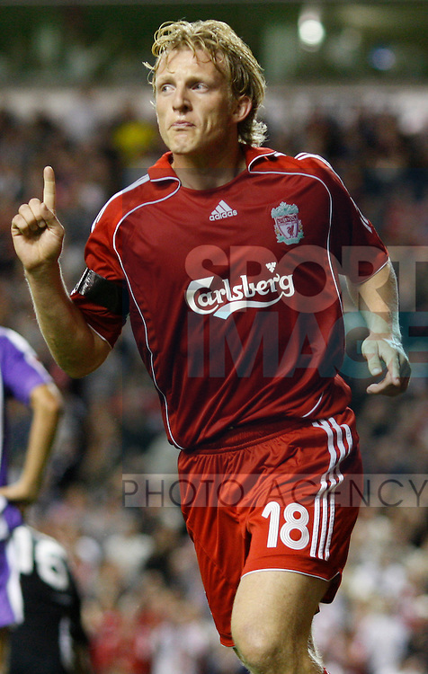 Liverpool's Dirk Kuyt turns to celebrate his goal Liverpool's third