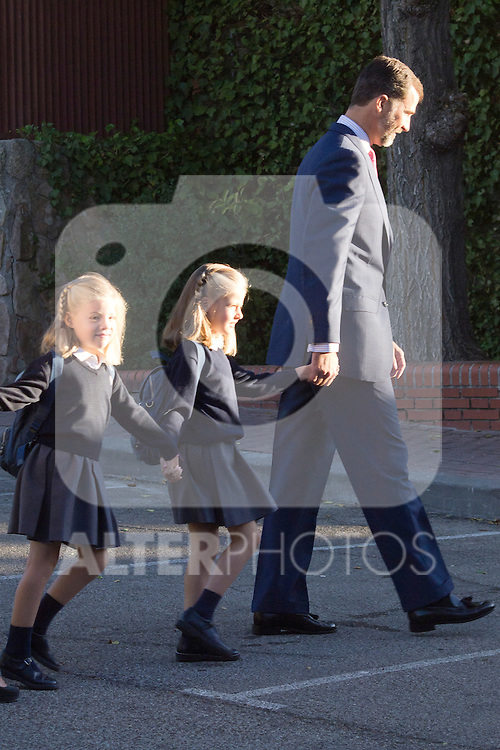14.09.2012. Prince Felipe of Spain, Princess Letizia of Spain and their daughters Leonor and Sofia  arrive at 'Santa Maria de los Rosales' School in Aravaca near of Madrid, Spain. In the image (L-R) Princess Sofia, Princess Leonor and Prince Felipe (Alterphotos/Marta Gonzalez)