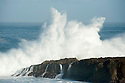 Waves crashing on rocks in Hawaii
