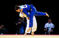 04 DEC 2011 - LONDON, GBR - Maria Portela (BRA) (in white) throws  Sally Conway (GBR) (in blue) to win the women's -70kg final at the London International Judo Invitational and 2012 Olympic Games test event at the ExCel Exhibition Centre in London, Great Britain .(PHOTO (C) NIGEL FARROW)