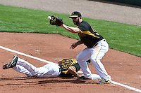 Pittsburgh Pirates first baseman Brent Morel (53) catches a throw as Steve Lombardozzi (23) dives back to first during the Black & Gold intrasquad game on March 2, 2015 at McKechnie Field in Bradenton, Florida.  (Mike Janes/Four Seam Images)