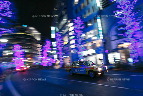 A Japanese taxi rides past the Blue Grotto Shibuya illuminations on November 22, 2017, Tokyo, Japan. Thousands of blue LED lights turn the streets from Yoyogi Park to Koen Dori into a 800-meter cave. The event runs til December 31, 2017. (Photo by Rodrigo Reyes Marin/AFLO)