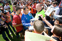 USA head coach Bruce Arena signs autographs after training in Hamburg, Germany, for the 2006 World Cup, June, 6, 2006.