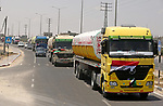 Egyptian trucks carrying fuel drive down a street after entering the southern Gaza Strip from Egypt through the Rafah border crossing on June 21, 2017. Egypt began to deliver a million litres of fuel to Gaza, a Palestinian official said, in an attempt to ease the Palestinian enclave's desperate electricity crisis. The fuel, trucked in through the Rafah border between Egypt and Gaza, will be routed to the territory's only power station -- closed since April due to fuel shortages. Photo by Ashraf Amra