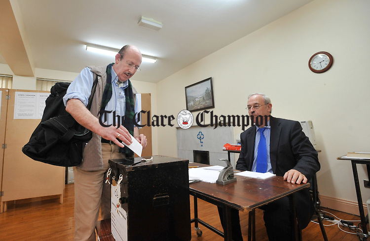 Johnny Mahony casts his vote for the Lisbon Treaty in Ennistymon as Martin O' Malley, presiding officer, looks on. Photograph by Declan Monaghan