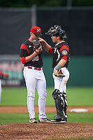 Batavia Muckdogs relief pitcher Trenton Hill (39) talks with catcher David Gauntt (49) during a game against the West Virginia Black Bears on June 28, 2016 at Dwyer Stadium in Batavia, New York.  Batavia defeated West Virginia 3-1.  (Mike Janes/Four Seam Images)