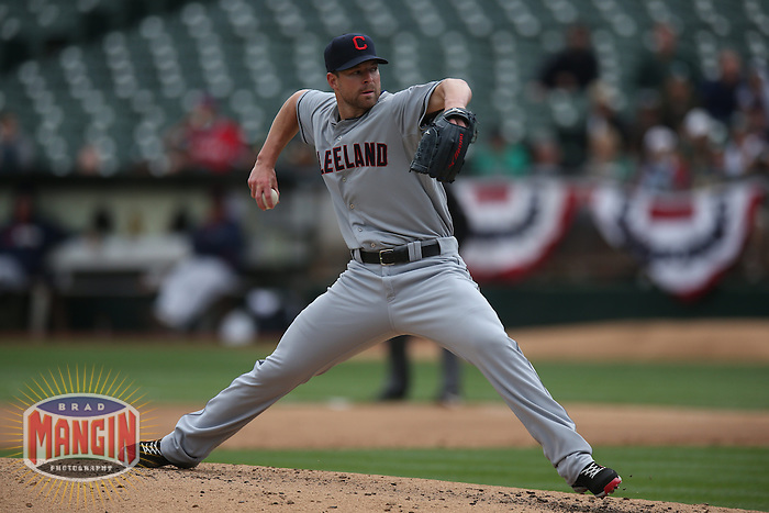 OAKLAND, CA - APRIL 2:  Corey Kluber #28 of the Cleveland Indians pitches against the Oakland Athletics during the game at O.co Coliseum on Wednesday, April 2, 2014 in Oakland, California. Photo by Brad Mangin