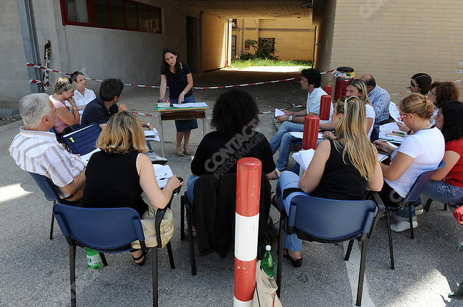 Mature nurses, students from L'Aquila university, took part in an English class outside the hospital, still closed from April's devastation earthquake. May 23, 2009