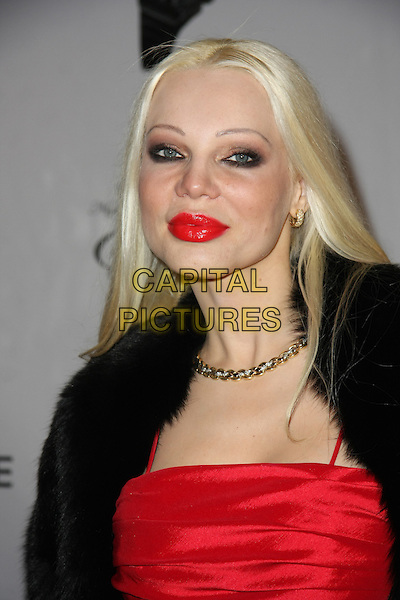 MARINA PAHOMOVA .21st Annual Night of 100 Stars Awards Gala Celebrating the 83rd Annual Academy Awards Held at The Beverly Hills Hotel,  Beverly Hills, California, USA, 27th February 2011..portrait headshot red lipstick black fur make-up .CAP/ADM/TB.©Tommaso Boddi/AdMedia/Capital Pictures.