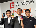 July 27th, 2011, Tokyo, Japan - Heads of Japans three leading communication companies proudly shows off Toshiba-Fujitsu IS12T handsets, the worlds first Windows Phone 7.5, launched jointly by KDDI, Fujitsu and Japan Microsoft in Tokyo on Wednesday, July 27, 2011. They are, from left: Nobuo Otani, president of Fujitsu Toshiba Mobile Communications Ltd.; Koji Tanaka, president of KDDI; and Yasuyuki Higuchi, president and CEO of Microsoft Japan. Manufactured by Fujitsu Toshiba Mobile Communications Ltd, the IS12T is Japan's first water- and dust-proof smartphone featuring Windows Phone 7.5, otherwise known as Mango. In addition to much smoother operability compared to conventional smartphones, the device offers the highest quality camera for a smartphone with 13.2-megapixels, and 32 GB of internal memory, while realizing a compact size. Users can not only read and edit Microsoft Office documents, but can also store and share data through Windows Live SkyDrive, a free-of-charge cloud service operated by Microsoft. The Windows phone will be available after September 2011.  (Photo by Natsuki Sakai/AFLO) [3615] -mis-