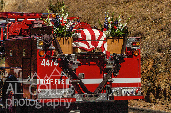 September 20, 2004 Angels Camp, California --Tuolumne Fire –- CDF Engine 4474 with fallen firefighter Eva Marie Schicke's casket crosses Parrots Ferry Bridge on way to her memorial service held at the Calaveras County Fairgrounds.  The Tuolumne Fire was a small very fast-moving fire that started around noon on September 12, 2004 near Lumsden Bridge at the bottom of the Tuolumne River.  The fire moved rapidly up the 80-plus-degree slope catching Cal Fire Helitack firefighters, tragically killing firefighter Eva Marie Schicke and injuring five others.