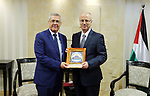 Palestinian Prime Minister Rami Hamdallah meets with Minister Delegate to the Prime Minister in the Kingdom of Morocco Mohammed Ben Abdelkader, at his office in the West Bank city of Ramallah on May 2, 2018. Photo by Prime Minister Office