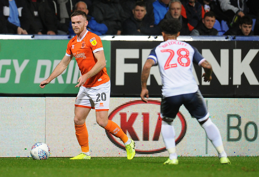 Blackpool's Oliver Turton under pressure from Bolton Wanderers' Liam Bridcutt<br /> <br /> Photographer Kevin Barnes/CameraSport<br /> <br /> The EFL Sky Bet League One - Bolton Wanderers v Blackpool - Monday 7th October 2019 - University of Bolton Stadium - Bolton<br /> <br /> World Copyright © 2019 CameraSport. All rights reserved. 43 Linden Ave. Countesthorpe. Leicester. England. LE8 5PG - Tel: +44 (0) 116 277 4147 - admin@camerasport.com - www.camerasport.com