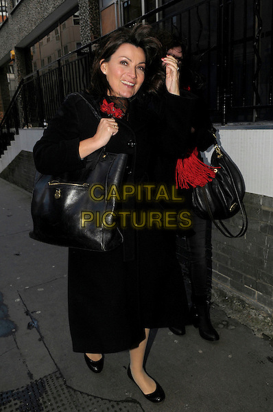 Lorraine Kelly spotted in central London, England..5th January 2012.full length black coat bag purse hand .CAP/IA.©Ian Allis/Capital Pictures.