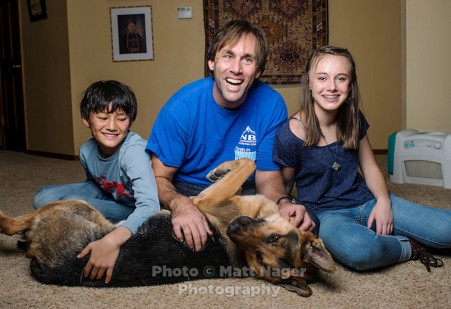 Blind Adventurer and Motivational Speaker Erik Weihenmayer (cq), with his children Emma Weihenmayer(cq, age 13), Arjun Weihenmayer (cq, age 11), and his service dog near their home in Golden, Colorado on Wednesday, December 18, 2013. Despite losing his vision at the age of 13, Erik Weihenmayer has become one of the most accomplished adventurers in the world. Weihenmayer is the only blind person who has reached the summit of Mount Everest and the tallest peak on each continent.<br /> <br /> Photo by Matt Nager