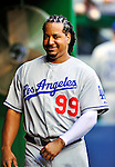 23 April 2010: Los Angeles Dodgers' left fielder Manny Ramirez smiles in the dugout prior to a game against the Washington Nationals at Nationals Park in Washington, DC. The Nationals defeated the Dodgers 5-1 in the first game of their 3-game series. Mandatory Credit: Ed Wolfstein Photo