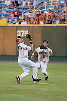 South Carolina 2B Scott Wingo and RF Whit Merrifield in Game 14 of the NCAA Division One Men's College World Series on June 26th, 2010 at Johnny Rosenblatt Stadium in Omaha, Nebraska.  (Photo by Andrew Woolley / Four Seam Images)