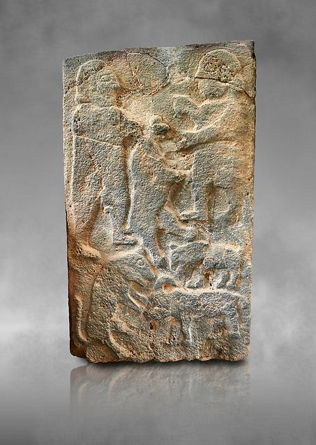 Pictures & images of the North Gate Hittite sculpture stele men hunting. 8th century BC.  Karatepe Aslantas Open-Air Museum (Karatepe-Aslantaş Açık Hava Müzesi), Osmaniye Province, Turkey. Against grey art background