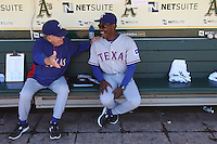 OAKLAND, CA - JUNE 7:  Coach Jackie Moore #4 and manager Ron Washington #38 of the Texas Rangers joke around in the dugout before the game against the Oakland Athletics at O.co Coliseum on Thursday June 7, 2012 in Oakland, California. Photo by Brad Mangin