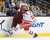 Peter Starrett (Harvard - 14), Max Nicastro (BU - 7) - The Harvard University Crimson defeated the Boston University Terriers 5-4 in the 2011 Beanpot consolation game on Monday, February 14, 2011, at TD Garden in Boston, Massachusetts.