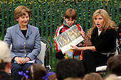 "Jenna Bush, left, reads from the book, ""Where the Wild Things Are,"" as her mother First Lady Laura Bush looks on to kids at the annual White House Easter Egg Roll March 24, 2008 on the South Lawn of the White House in Washington, DC. The Easter Egg Roll is a traditional all-American event held on the White House lawn each year since 1878, where kids compete by using a giant wooden spoon to push an egg. <br /> Credit: Ken Cedeno / Pool via CNP"