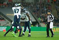 Seattle Seahawks celebrate a sack on Oakland Raiders Quarterback Derek Carr (4)