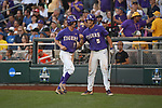 OMAHA, NE - JUNE 26: Zach Watson (9) of Louisiana State University is greeted by teammate Jake Slaughter (5) after scoring a run against the University of Florida during the Division I Men's Baseball Championship held at TD Ameritrade Park on June 26, 2017 in Omaha, Nebraska. The University of Florida defeated Louisiana State University 4-3 in game one of the best of three series. (Photo by Justin Tafoya/NCAA Photos via Getty Images)