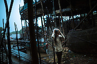 August 29, 2012 - Siem Reap (Cambodia). A young girl has a shower under a torrential rain in the small village of Kompong Phluk, a few km outside Siem Reap. © Thomas Cristofoletti / Ruom