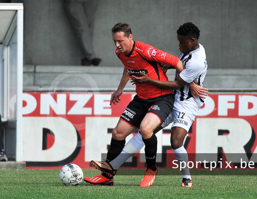 Winkel Sport - KAS Eupen : Vincent Bostoen schermt de bal af voor Ndumiso Mngadi (rechts)<br /> foto VDB / Bart Vandenbroucke