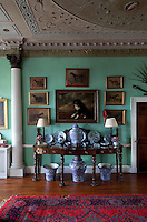 A n early Georgian sideboard in the hall is used to display a collection of blue and white ceramics