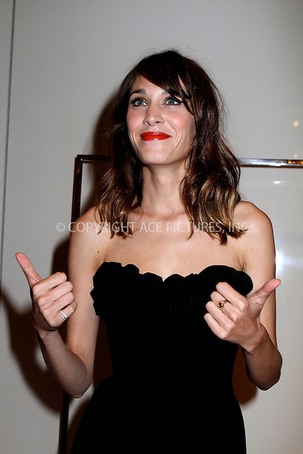 WWW.ACEPIXS.COM....September 6 2012, New York City....TV personality Alexa Chung DJs at the Moschino store in the Meatpacking district, for Fashion Night Out on September 6 2012 in New York. ....By Line: Nancy Rivera/ACE Pictures......ACE Pictures, Inc...tel: 646 769 0430..Email: info@acepixs.com..www.acepixs.com