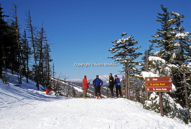 Skiers and snowboarders on a trail at Sunday River Ski Area in Newry, Maine, USA