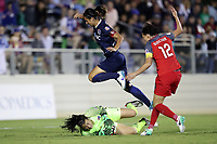 Cary, NC - Saturday April 22, 2017: Sabrina D'Angelo (in green) grabs the ball at the feet of Abby Erceg (above) and Christine Sinclair (12) during a regular season National Women's Soccer League (NWSL) match between the North Carolina Courage and the Portland Thorns FC at Sahlen's Stadium at WakeMed Soccer Park.