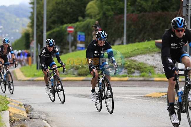 The peloton led by Team Sky speed through Calco during the last classic of the season Il Lombardia 2015 running 245km from Bergamo to Como, Italy. 4th October 2015.<br /> Picture: Eoin Clarke | Newsfile