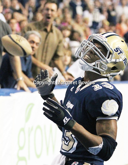 05 June 2010: Tampa Bay wide receiver DeAndrew Rubin is dismayed that he cannot quite catch the long pass from quarterback Brett Dietz.  The Tampa Bay Storm defeated the Oklahoma City Yard Dawgz 50-48 at the St. Pete Forum in Tampa, Florida