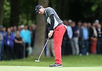 Rory McIlroy putts on the 1st - BMW Golf at Wentworth - Day 2 - 22/05/15 - MANDATORY CREDIT: Rob Newell/GPA/REX -