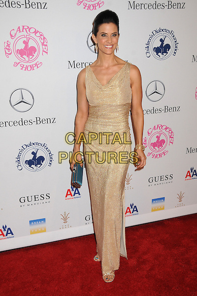 Lu Parker.26th Annual Carousel of Hope Gala held at the Beverly Hilton Hotel, Beverly Hills, California, USA, 20th October 2012..full length gold long maxi dress sleeveless clutch bag blue .CAP/ADM/BP.©Byron Purvis/AdMedia/Capital Pictures.