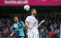 Michael Nelson of Barnet passes back to the keeper during the Sky Bet League 2 match between Wycombe Wanderers and Barnet at Adams Park, High Wycombe, England on 22 October 2016. Photo by Andy Rowland.