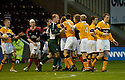 25/11/2006       Copyright Pic: James Stewart.File Name :sct_jspa26_motherwell_v_falkirk.TEMPERS FLARE AFTER MOTHERWELL IS AWARDED A SECOND PENALTY.James Stewart Photo Agency 19 Carronlea Drive, Falkirk. FK2 8DN      Vat Reg No. 607 6932 25.Office     : +44 (0)1324 570906     .Mobile   : +44 (0)7721 416997.Fax         : +44 (0)1324 570906.E-mail  :  jim@jspa.co.uk.If you require further information then contact Jim Stewart on any of the numbers above.........