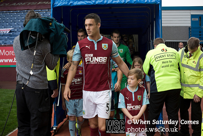 Burnley 1 West Ham United 3, 18/10/2014. Turf Moor, Premier League. Home team captain Jason Shackell leading his team onto the pitch at Turf Moor, home of Burnley FC, on the day the club hosted West Ham United in an English Premier League match. The fixture was won by the visitors by three goals to one watched by 18,936 spectators. The defeat meant that Burnley still had not won a league match since being promoted from the Championship the previous season. Photo by Colin McPherson.