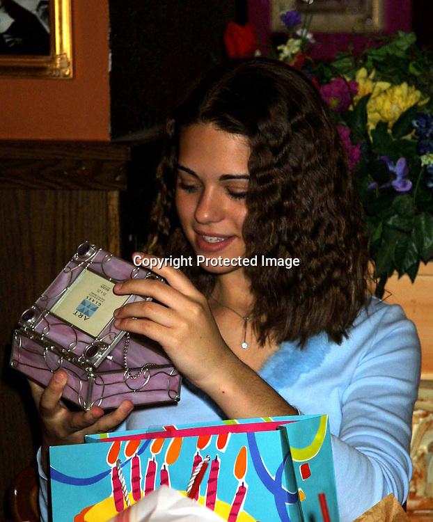 © 2003 KATHY HUTCHINS / HUTCHINS PHOTO.LYNDSY FONSECA SWEET 16 BIRTHDAY PARTY.Buca di Beppo Resturant.ENCINO, CA.JANUARY 7, 2003..LYNDSY FONSECA...