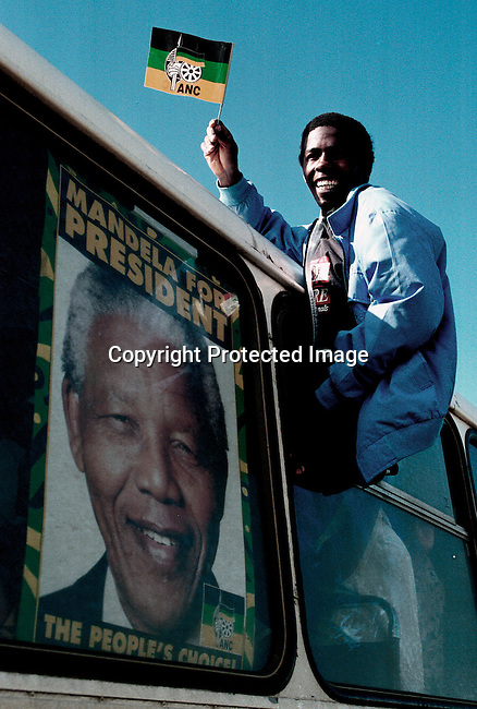 An ANC (African National Congress) supporter at a election rally a few days before the historic democratic election in South Africa on April 27, 1994; poster in bus window with man holding flag.(Photo: Per-Anders Pettersson/)