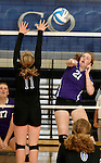 SIOUX FALLS, SD - SEPTEMBER 25: Elizabeth Lammers #21 from Dakota Valley tries to get a kill past Amy Hurley #11 from Sioux Falls Christian in the second game of their match Thursday night at Sioux Falls Christian High.  (Photo by Dave Eggen/Inertia)