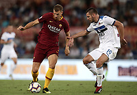 Calcio, Serie A: Roma - Atalanta, Stadio Olimpico, 27 agosto, 2018.<br /> Roma's Edin Dzeko (l) in action with Atalanta's Berat Djimsiti (r) during the Italian Serie A football match between Roma and Atalanta at Roma's Stadio Olimpico, August 27, 2018.<br /> UPDATE IMAGES PRESS/Isabella Bonotto
