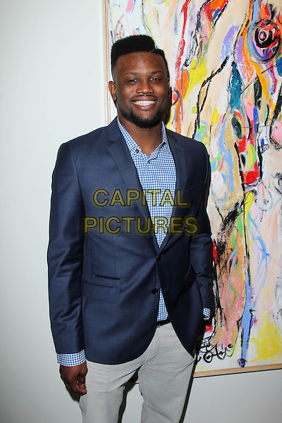 LOS ANGELES, CA - March 08: Walter Thurmond at the Alexander Yulish &quot;An Unquiet Mind&quot; Reception, KM Fine Arts, Los Angeles,  March 08, 2014.  <br /> CAP/MPI/JO<br /> &copy;Janice Ogata/MediaPunch/Capital Pictures
