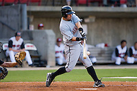 Lee Cruz #22 of the Birmingham Barons makes contact with the baseball at Five County Stadium August 15, 2009 in Zebulon, North Carolina. (Photo by Brian Westerholt / Four Seam Images)